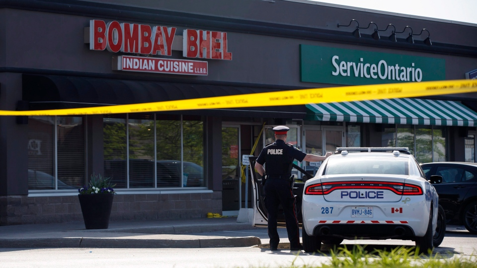 A Police officer stands watch at the scene of an explosion at a restaurant in Mississauga, Ont. on Friday, May 25, 2018. THE CANADIAN PRESS/Cole Burston