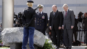 Unveiling a monument to honour those who have fallen in NATO operations at NATO headquarters in Brussels. (Virginia Mayo / AP)