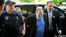 Harvey Weinstein is escorted into court, Friday, May 25, 2018, in New York. (AP Photo/Mark Lennihan)