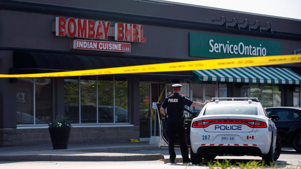 A police officer stands watch at the scene of an explosion at a restaurant in Mississauga, Ont. on Friday, May 25, 2018. (THE CANADIAN PRESS/Cole Burston)