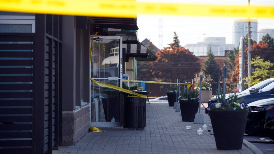 Police tape and medical material can be seen at the scene of an explosion at a restaurant in Mississauga, Ont. on Friday, May 25, 2018. (THE CANADIAN PRESS/Cole Burston)