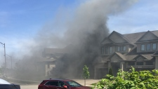 Smoke from a garage fire rises above Oak Park Drive in Waterloo on Friday, May 25, 2018. (McKenna Szczepanowski)