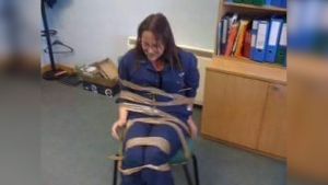 DeeAnn Fitzpatrick during an alleged incident where her coworkers taped her to a chair for complaining about harassment in the office. (THE CANADIAN PRESS/HO-Sherry Fitzpatrick)
