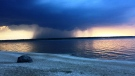 Storm clouds while looking west down Albert Beach. Photo by Dale Kerr.