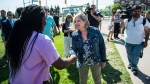 Ontario NDP leader Andrea Horwath meets students after an announcement to media regarding her plan to support School infrasturcture outside Sir Oliver Mowat Collegiate Institute in Toronto on Friday, May 25, 2018. (THE CANADIAN PRESS/Aaron Vincent Elkaim)