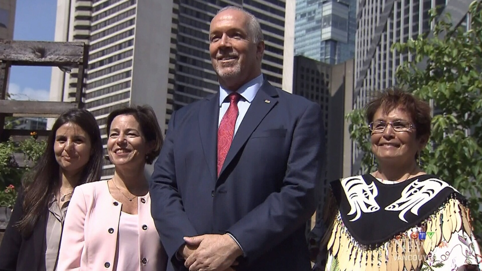 From left to right, Gisele, a survivor of domestic violence, Minister for Municipal Affairs and Housing Selina Robinson, Premier John Horgan and Musqueam Nation elder Jewel Thomas at a news conference announcing new funding for women escaping domestic violence.