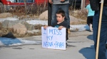 Zayden Oman holds a sign at the Churchill rail line rally on Wednesday, May 23. (Source: Katie deMuelles)