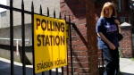 A woman leaves a polling station after casting her vote in the referendum on the 8th Amendment of the Irish Constitution, in Dublin, Ireland, Friday May 25, 2018. (AP Photo/Peter Morrison)