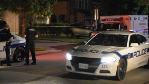 Police are shown at the scene of a fatal stabbing in Mississauga early Saturday morning. (Dave Ritchie)