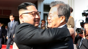In this photo provided by South Korea Presidential Blue House via Yonhap News Agency, North Korean leader Kim Jong Un, left, and South Korean President Moon Jae-in embrace each other after their meeting at the northern side of the Panmunjom in North Korea, Saturday, May 26, 2018. (South Korea Presidential Blue House/Yonhap)