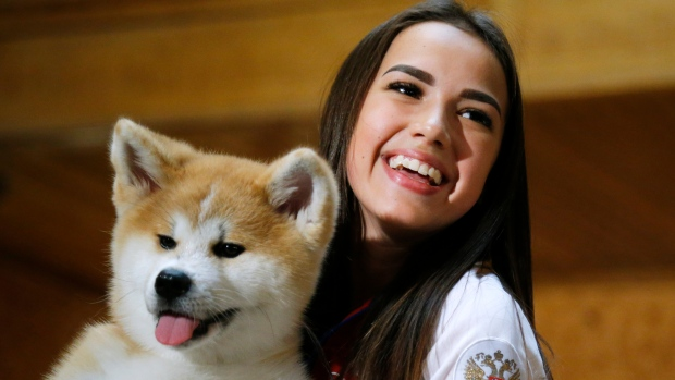 Russian Women's Olympic Figure Skating Gold medalist Alina Zagitova holds An Akita Inu puppy named Masaru presented by Japanese Prime Minister Shinzo Abe, in Moscow, Russia, Saturday, May 26, 2018. (AP Photo/Alexander Zemlianichenko, Pool)
