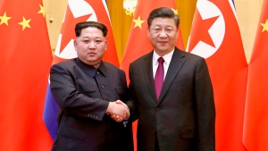 In this March 28, 2018, file photo, released by China's Xinhua News Agency, North Korean leader Kim Jong Un, left, and Chinese President Xi Jinping poses for a photo in Beijing, China. (Ju Peng/Xinhua via AP, File)