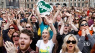 """People from the """"Yes"""" campaign react as the results of the Irish referendum on the 8th Amendment of the Irish Constitution are heard, at Dublin Castle, in Dublin, Ireland, Saturday May 26, 2018.  (AP Photo/Peter Morrison)"""