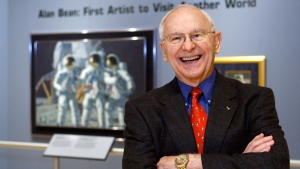 In this Oct. 1, 2008, file photo, Alan Bean, the fourth man to walk on the moon, is shown during a preview of his work at the Lyndon Baines Johnson Library and Museum in Austin, Texas. (AP Photo/Harry Cabluck, File)