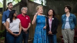 Ontario Liberal Leader Kathleen Wynne speaks to meida alongside candidates, left to right, Sumi Shan, David Morris, David Zimmer, Li Koo, Jo-Ann Davis in the backyard of Marie-Andree Maurice in Toronto on Saturday, May 26, 2018. THE CANADIAN PRESS/Aaron Vincent Elkaim
