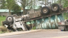Liquid fertilizer spills after tanker flips