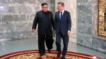 In this May 26, 2018, photo provided on May 27, 2018, by the North Korean government, North Korean leader Kim Jong Un, left, and South Korean President Moon Jae-in, right, walk together to their meeting at the northern side of Panmunjom in North Korea. (Korean Central News Agency/Korea News Service via AP)