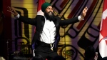NDP Leader Jagmeet Singh dances on stage after teaching a group of reporters Punjabi dance moves during his speech at the Parliamentary Press Gallery Dinner at the Museum of History in Gatineau, Quebec on Saturday, May 26, 2018. (THE CANADIAN PRESS/Justin Tang)