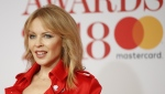 Australian singer and actress Kylie Minogue poses on the red carpet on arrival for the BRIT Awards 2018 in London on February 21, 2018. (© Tolga AKMEN / AFP)
