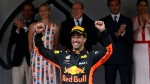 Red Bull driver Daniel Ricciardo of Australia celebrates on the podium after winning the Formula One race, at the Monaco racetrack, in Monaco, Sunday, May 27, 2018. (AP Photo/Luca Bruno)