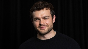 "In this May 12, 2018 photo, actor Alden Ehrenreich, who portrays a young Han Solo in the film, ""Solo: A Star Wars Story"" appears at a portrait session in Pasadena, Calif. The film tells the backstory of the character that Harrison Ford played over a span of several decades. (Photo by Willy Sanjuan/Invision/AP)"