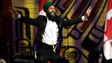 NDP Leader Jagmeet Singh dances on stage after teaching a group of reporters Punjabi dance moves during his speech at the Parliamentary Press Gallery Dinner at the Museum of History in Gatineau, Quebec on Saturday, May 26, 2018. THE CANADIAN PRESS/Justin Tang