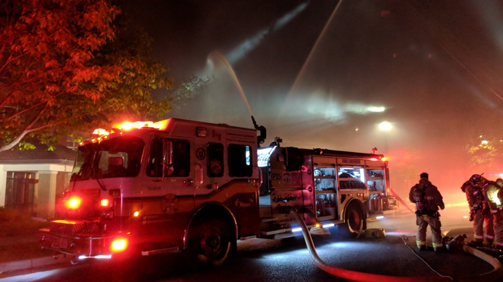 Woman in critical condition after overnight apartment fire