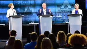 Ontario Progressive Conservative Leader Doug Ford, centre, speaks as Ontario Liberal Leader Kathleen Wynne, left, and Ontario NDP Leader Andrea Horwath look on during the third and final televised debate of the provincial election campaign in Toronto, Sunday, May 27, 2018. THE CANADIAN PRESS/Frank Gunn