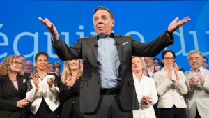 Coalition Avenir Quebec Leader Francois Legault gestures to supporters at a general council meeting, Sunday, May 27, 2018 in Levis, Que. (THE CANADIAN PRESS/Jacques Boissinot)