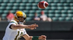 Edmonton Eskimos quarterback Mike Reilly makes the pass against the Saskatchewan Roughriders during first half CFL pre-season action in Edmonton, Alta., on Sunday May 27, 2018. THE CANADIAN PRESS/Jason Franson.