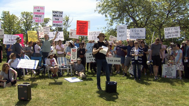 Demonstrators for and against the tax gathered in Point Grey Sunday.