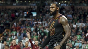 Cleveland Cavaliers forward LeBron James celebrates a basket against the Boston Celtics during the second half in Game 7 of the NBA basketball Eastern Conference finals in Boston on Sunday, May 27, 2018. (AP Photo/Elise Amendola)