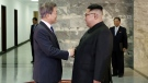 """In this May 26, 2018 photo provided on May 27, 2018, by South Korea Presidential Blue House, North Korean leader Kim Jong Un, right, and South Korean President Moon Jae-in, left, shake hands before their meeting at the northern side of Panmunjom in North Korea. Moon said Sunday, May 27, that Kim committed in the rivals' surprise meeting to sitting down with President Donald Trump and to a """"complete denuclearization of the Korean Peninsula."""" The Korean leaders' second summit in a month Saturday, May 26, saw bear hugs and broad smiles, but their quickly arranged meeting appears to highlight a sense of urgency on both sides of the world's most heavily armed border. (South Korea Presidential Blue House via AP)"""