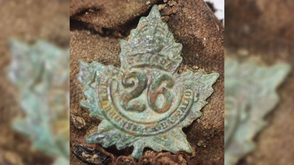 A collar badge from the 26th Canadian Infantry Battalion (New Brunswick), found with the remains of Private Thomas.