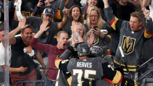 In this Friday, May 18, 2018, file photo, Vegas Golden Knights left wing Tomas Nosek, left, celebrates with teammates after scoring against the Winnipeg Jets during the second period of Game 4 of the NHL hockey Western Conference finals in Las Vegas. THE CANADIAN PRESS/AP Photo/John Locher