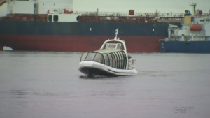 A ferry runs from Pointe aux Trembles to Montreal's Old Port on the first day of a one-week pilot project