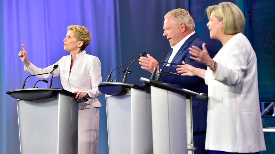 Ontario Liberal Leader Kathleen Wynne, left to right, Ontario Progressive Conservative Leader Doug Ford and Ontario NDP Leader Andrea Horwath participate during the third and final televised debate of the provincial election campaign in Toronto, Sunday, May 27, 2018. (THE CANADIAN PRESS/Frank Gunn)