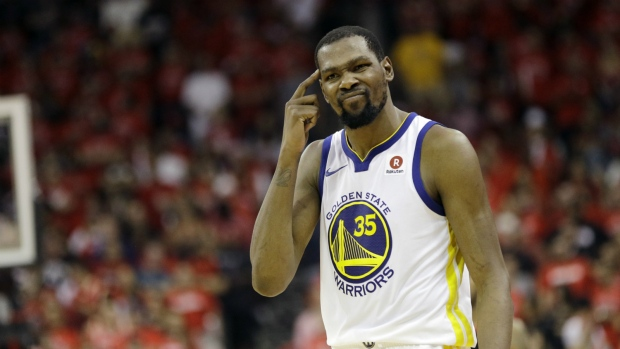 57f96eb48647 Kevin Durant in action against the Rockets. Golden State Warriors forward Kevin  Durant reacts after ...