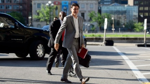 Prime Minister Justin Trudeau arrives for an early morning cabinet meeting on Parliament Hill in Ottawa on Tuesday, May 29, 2018. THE CANADIAN PRESS/Sean Kilpatrick