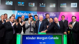 Ian Anderson, centre, President, Kinder Morgan Canada Limited opens the market in Toronto on Friday, June 2, 2017. THE CANADIAN PRESS/Nathan Denette