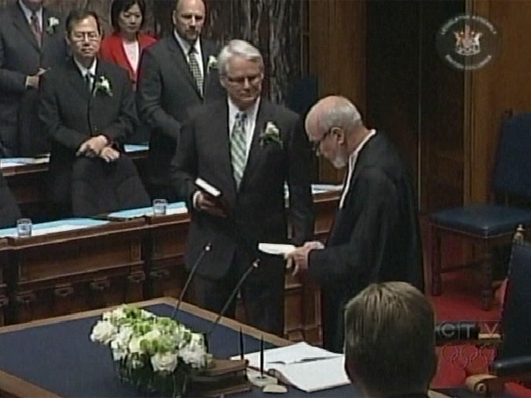 B.C. Premier Gordon Campbell is sworn in during a ceremony at the British Columbian legislature in Victoria on June 8, 2009.