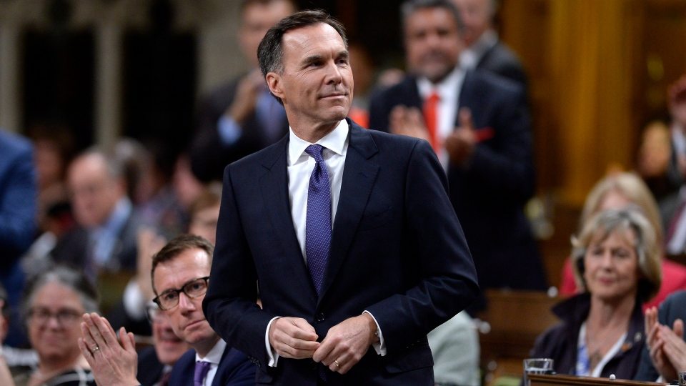 Minister of Finance Bill Morneau rises during Question Period in the House of Commons on Parliament Hill in Ottawa on Tuesday, May 29, 2018. THE CANADIAN PRESS/Justin Tang