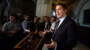 Conservative Leader Andrew Scheer speaks to reporters about the government's plan to buy the Trans Mountain pipeline, on Parliament Hill in Ottawa on Tuesday, May 29, 2018. THE CANADIAN PRESS/Justin Tang