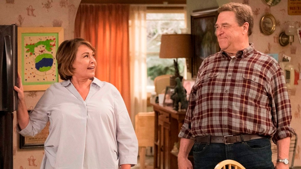 Roseanne Barr and John Goodman in a scene from 'Roseanne.' (Adam Rose / ABC via AP)