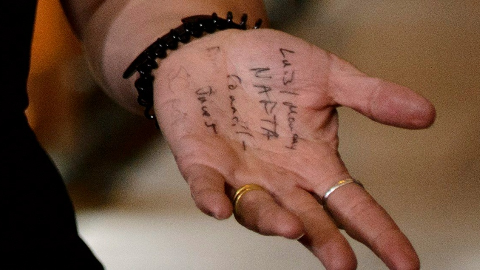 Notes are shown on Foreign Affairs Minister Chrystia Freeland's hand as she speaks to reporters following a caucus meeting on Parliament Hill in Ottawa on Wednesday, May 30, 2018. THE CANADIAN PRESS/Sean Kilpatrick