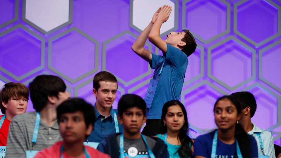 Joseph Benson, 14, from Kansas City, Mo., celebrates as he walks back to his seat after spelling his work correctly during the 3rd Round of the Scripps National Spelling Bee in Oxon Hill, Md., Wednesday, May 30, 2018. (AP Photo/Carolyn Kaster)