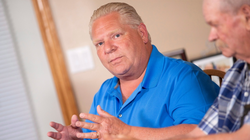 Doug Ford speaks to the media in the kitchen of Bill and Linda Reid in Reeces Corners, Ont. on Wednesday, May 30, 2018. THE CANADIAN PRESS/ Geoff Robins
