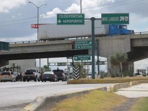 Traffic crosses over and under a major overpass in Nuevo Laredo, Mexico, Tuesday, July 16, 2013. (AP Photo/ Christopher Sherman)