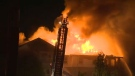 Crews from across the city were called to fight the four-alarm blaze and keep it from spreading to adjacent structures.