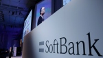 In this July 20, 2017, file photo, SoftBank Group Corp. Chief Executive Officer Masayoshi Son, left, speaks during a SoftBank World presentation at a hotel in Tokyo. (AP Photo/Shizuo Kambayashi, File)
